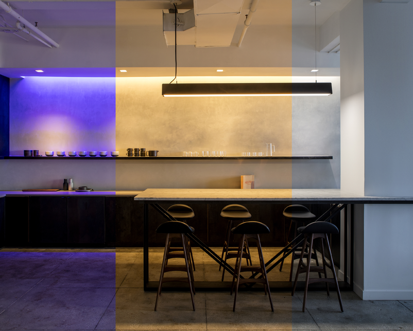 Purple light, warm white light, and brighter white light shown side by side in Ketra's NYC Showroom