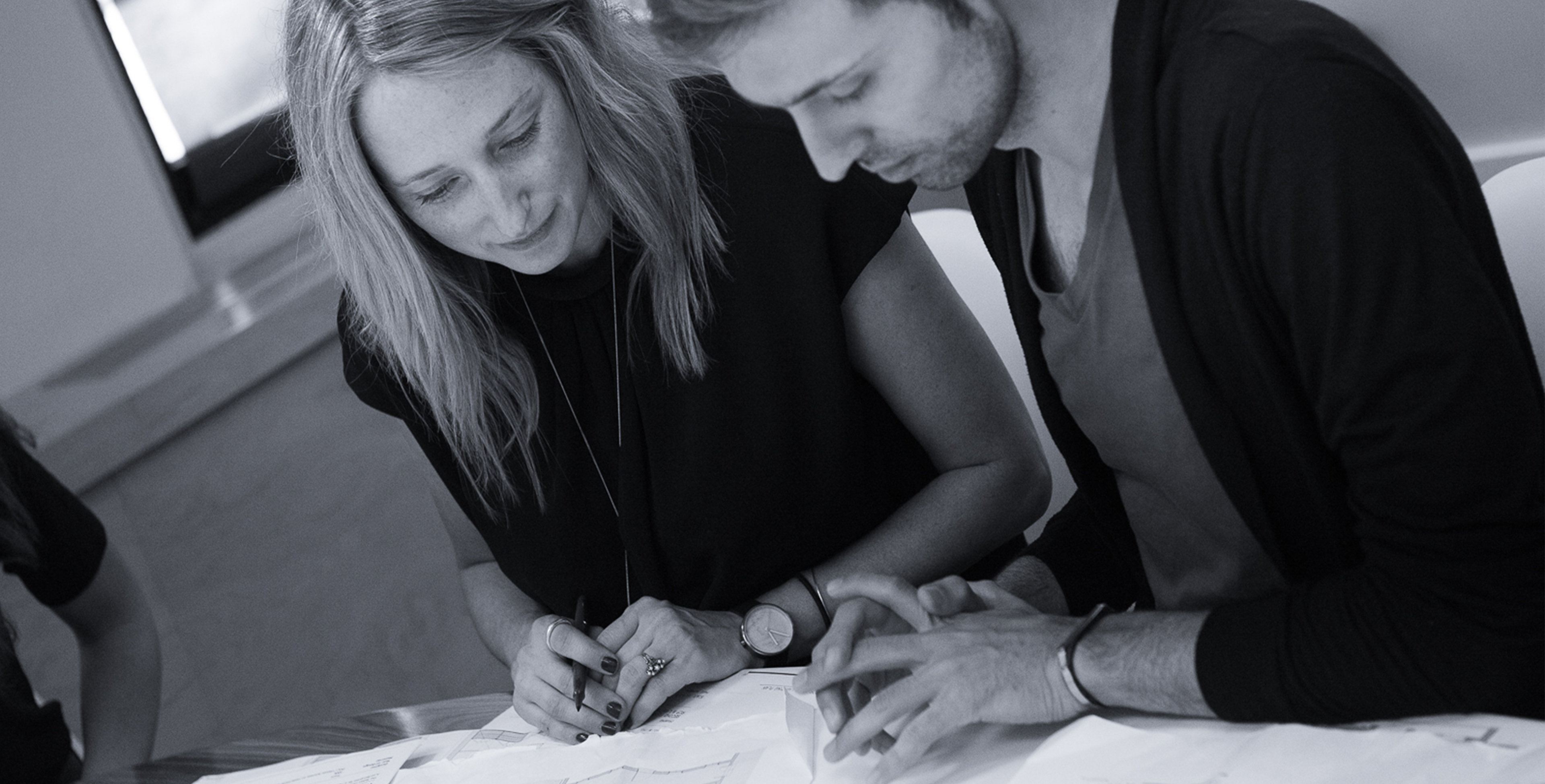 Erin and Scott working on a project for Tillotson Design Associates