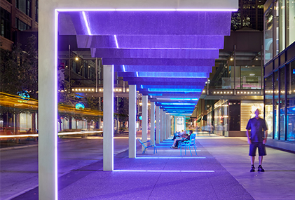 Purple light shines from Tillotson Design's installation at Nicollet Mall in Minneapolis, MN