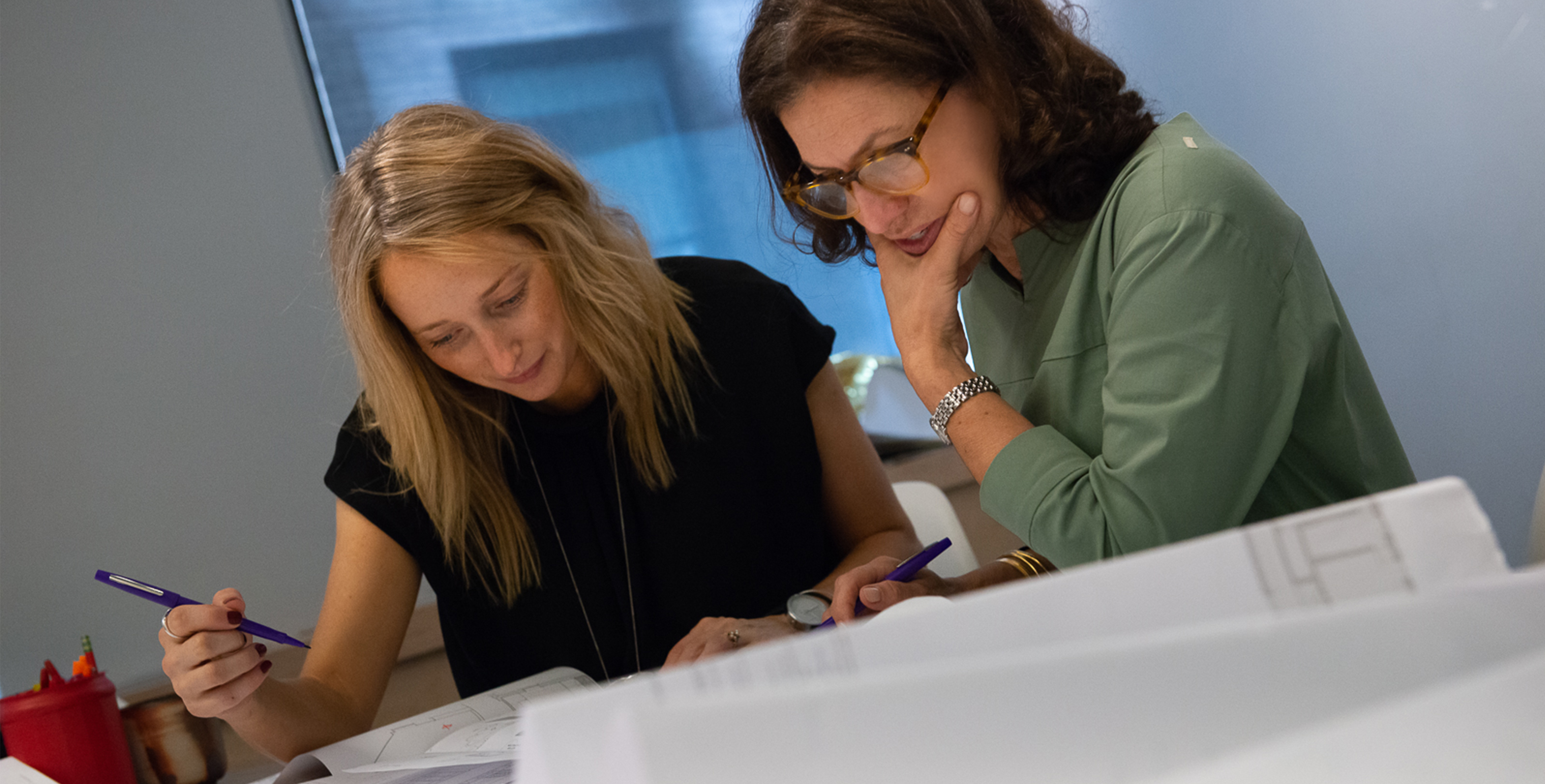 Suzan and Erin working on a project together for Tillotson Design Associates